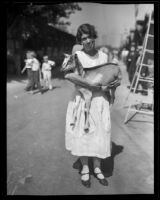 Woman holding a goat at the Los Angeles County Fair, Pomona, 1932