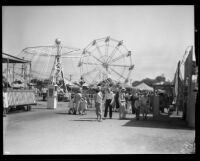 Amusement rides and the crowd at the Los Angeles County Fair, Pomona, 1932