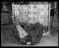 Woman sits with display of quilts at the Los Angeles County Fair, Pomona, 1932