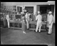 Los Angeles County General Hospital kitchen staff line up food delivery carts, Los Angeles, [1934]
