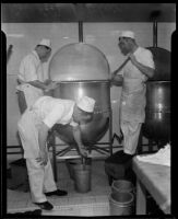 Cooks in the Los Angeles County General Hospital kitchen attend to a vat of cooking liquid, Los Angeles, [1934]