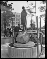 Sculptor Henry Lion competing the installation of his statue of Felipe de Neve in La Plaza Park, Los Angeles, 1932