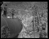 Crews work to fix a damaged section of the Los Angeles Aqueduct in No-Name Canyon, Inyo County vicinity, [about 1927]