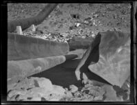 Close-up of a blast-damaged section of pipe along the Los Angeles Aqueduct in No-Name Canyon, Inyo County vicinity, [about 1927]
