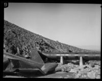 Damaged section of dynamited pipe along the Los Angeles Aqueduct in No-Name Canyon, Inyo County vicinity, [about 1927]