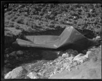 Section of blast-damaged conduit along the Los Angeles Aqueduct stretches across a stream in No-Name Canyon, Inyo County vicinity, [about 1927]