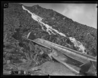 Damaged Los Angeles Aqueduct pipes lie on a hillside in No-Name Canyon, Inyo County vicinity, [about 1927]
