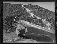 Blast-damaged Los Angeles Aqueduct pipes lie on a hillside in No-Name Canyon, Inyo County vicinity, [about 1927]