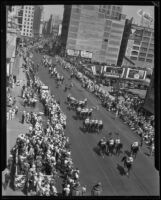 Riders and horses march in a parade for the Los Angeles birthday celebration, 1932