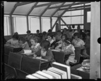 Los Angeles schoolchildren hard at work despite a dire learning environment, Los Angeles, 1935