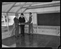 Three men transform a tent into a classroom, Los Angeles, 1935