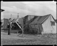 Resident of Hooverville hangs wash to dry, Los Angeles, 1930s