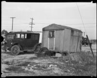 Car parked beside home in Alameda Hooverville, Los Angeles, 1930s