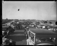 Scores of cars stop at the convergence of Vermont and Nomandie Avenues for the dedication ceremony of the new thoroughfare, Los Angeles, 1932
