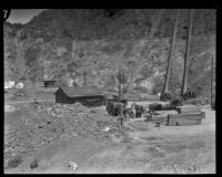 Penstocks and generators stand in the background at the rebuilding site of Power House #2, San Francisquito Canyon, 1928
