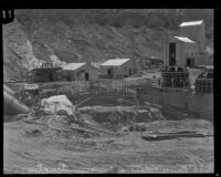 View of penstocks and generators on original bases during the reconstruction of the Bureau of Power and Light's Power House #2, San Francisquito Canyon, 1928