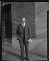 Dr. William Palmer Lucas poses on a sidewalk, Los Angeles vicinity, about 1926