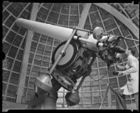 Maxwell K. Baughman looking through the Zeiss refracting telescope at the Griffith Observatory, Los Angeles, 1934-1935