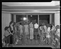 Visitors at an exhibit in the newly opened Griffith Observatory, Los Angeles, 1935