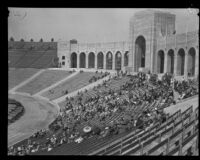 Spectators fill the stands of the Los Angeles Memorial Coliseum during an annual police inspection, Los Angeles, 1927
