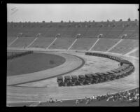 Police vehicles line the interior curve of the track at Los Angeles Memorial Coliseum during an inspection, Los Angeles, 1927