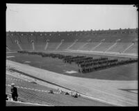 Panorama of police officers standing on the field at Los Angeles Memorial Coliseum during a police inspection, Los Angeles, 1927