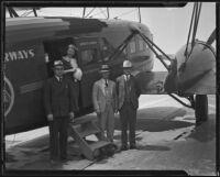Julian K. Lyles, Grace Richardson, Hugh L. Smith, and Ralph S. Damon land after a sleeper flight at the Grand Central Terminal, Glendale, 1934