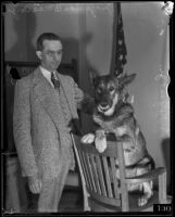Judge Charles B. MacCoy stands with police dog Peter the Great Jr., Los Angeles, 1934
