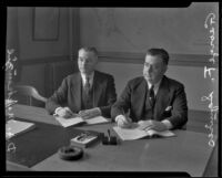 D. A. MacKenzie and George F. Squires signing labor contract, Los Angeles, 1935