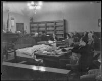 Murder bed displayed before jury in Nellie Madison case, Los Angeles, 1934