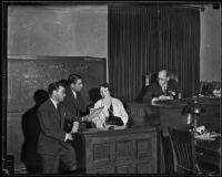 Judge Charles Fricke watches as Joseph Ryan and George Stahlman confer with Nellie May Madison on the stand, Los Angeles County, 1934