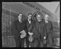 Rabbi Edgar F. Magnin, Bishop Bertrand Stevens, Thomas S. Evans, and Reverend Everett Clinchy pose in front of an airplane, Los Angeles, 1935