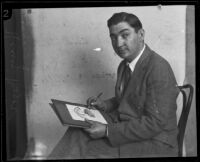 Portrait of caricaturist Henry Major as he draws one of his famous cartoons, Los Angeles, 1925