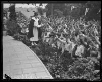 Aimee Semple McPherson with children during Angelus Temple services, Los Angeles, 1926