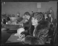 Aimee Semple McPherson gives a handwriting sample, Los Angeles, 1926