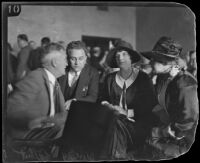 Roland Woolley, William I. Gilbert, Aimee Semple McPherson, and Minnie Kennedy in court, Los Angeles County, 1926