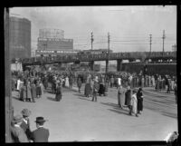 Crowd gathers at a train station to either welcome or bid farewell to Aimee Semple McPherson, Los Angeles, about 1926