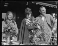 Reverend Paul Rader with Aimee Semple McPherson and Roberta Semple as they depart on their journey abroad, Los Angeles, 1926