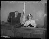 Aimee Semple McPherson-Hutton sits on the witness stand and Superior Judge Leon R. Yankwich presides, Los Angeles, 1934