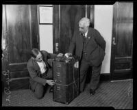 Investigators Chester Horn and Ben Cohn investigate a trunk alledgedly owned by Kenneth G. Ormiston, Los Angeles, 1926