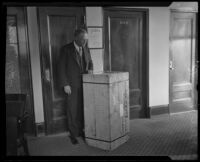 District Attorney Asa Keyes receives a crate of evidence, Los Angeles, 1926