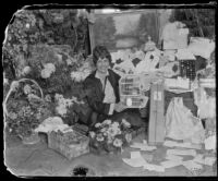 Aimee Semple McPherson with some of her birthday presents, Los Angeles, 1926