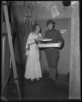 Harold Meyers, veteran, receives Christmas gifts from Aimee Semple McPherson-Hutton, Los Angeles, 1933