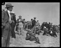 Large crowd gathers on Venice Beach during a search for the missing Aimee Semple McPherson, Los Angeles, 1926