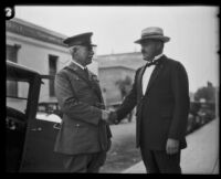 Major General James H. McRae shakes hands with his son Lieutenant Colonel Donald M. McRae, Los Angeles, 1926