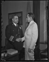 Chief of Police James E. Davis shakes hands with Volney P. Mooney, Jr., Los Angeles, 1935