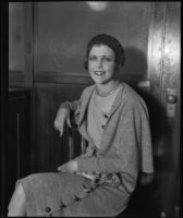 Madge Mitchell seated in a court house where she filed a lawsuit against William N. Fleischmann, Los Angeles, 1930