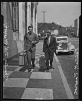 Kennett Longley Rawson and Charles John Vincent Murphy stroll down the sidewalk, Los Angeles, 1928