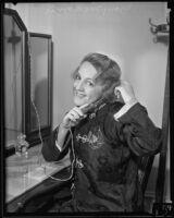Mary McCormic, opera singer, curls her hair, Los Angeles, 1935