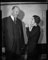Marie Reynolds points an admonishing finger at Senator J. W. McKinley, Los Angeles, 1934